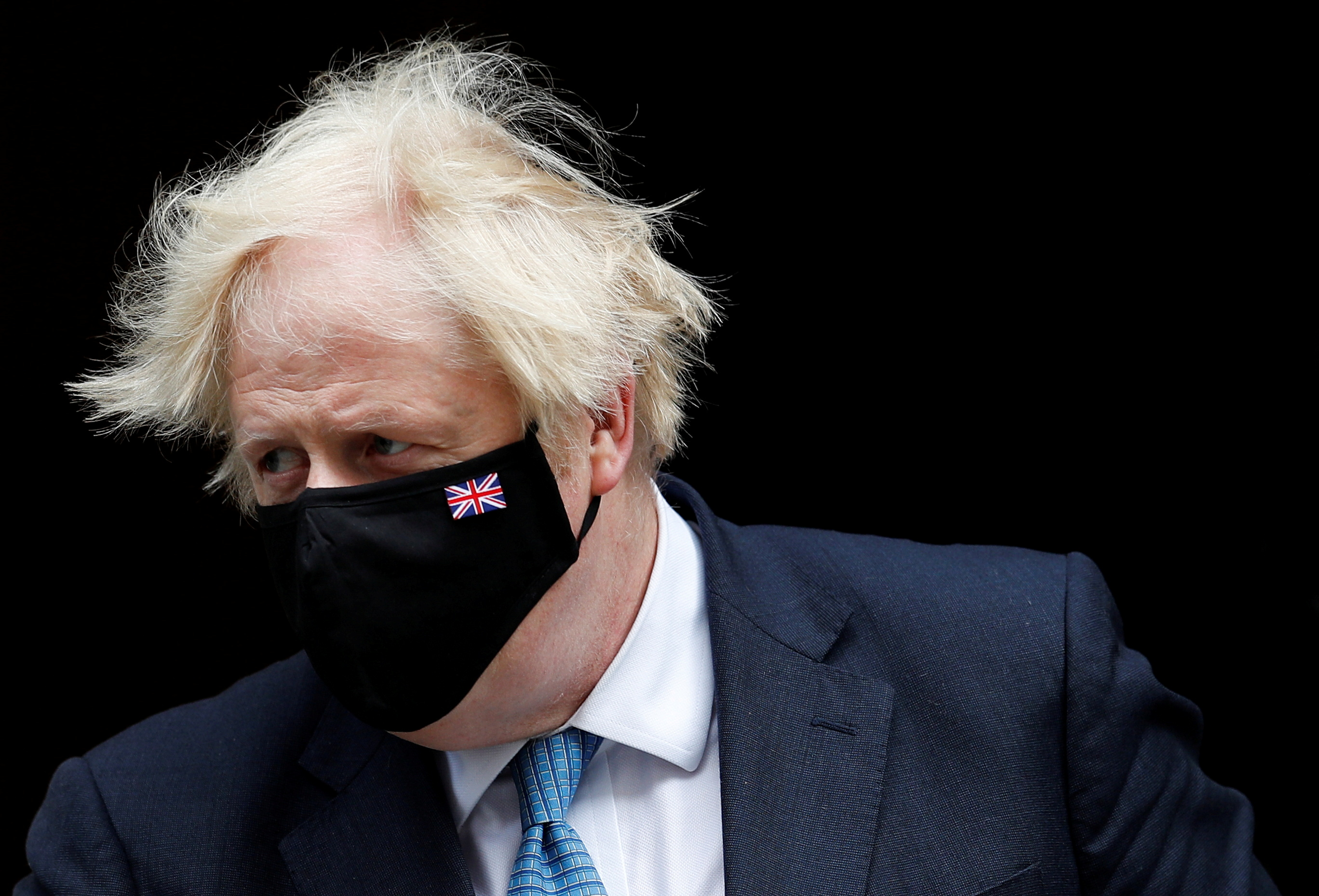 Britain's Prime Minister Boris Johnson walks on Downing Street in London, Britain, July 14, 2021. REUTERS/Peter Nicholls