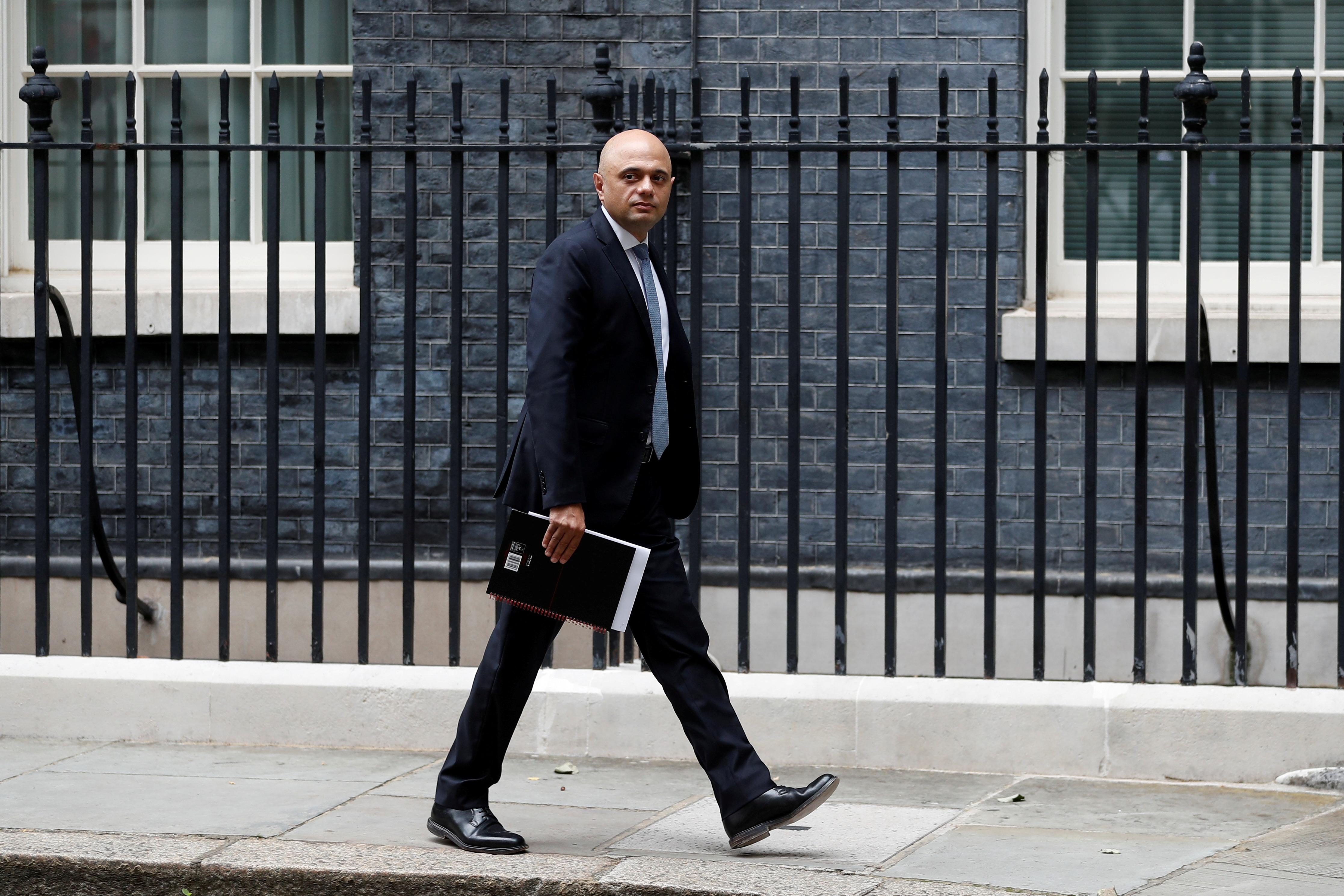 Britain's Health Secretary Sajid Javid walks on Downing Street in London, Britain, July 14, 2021. REUTERS/Peter Nicholls/File Photo