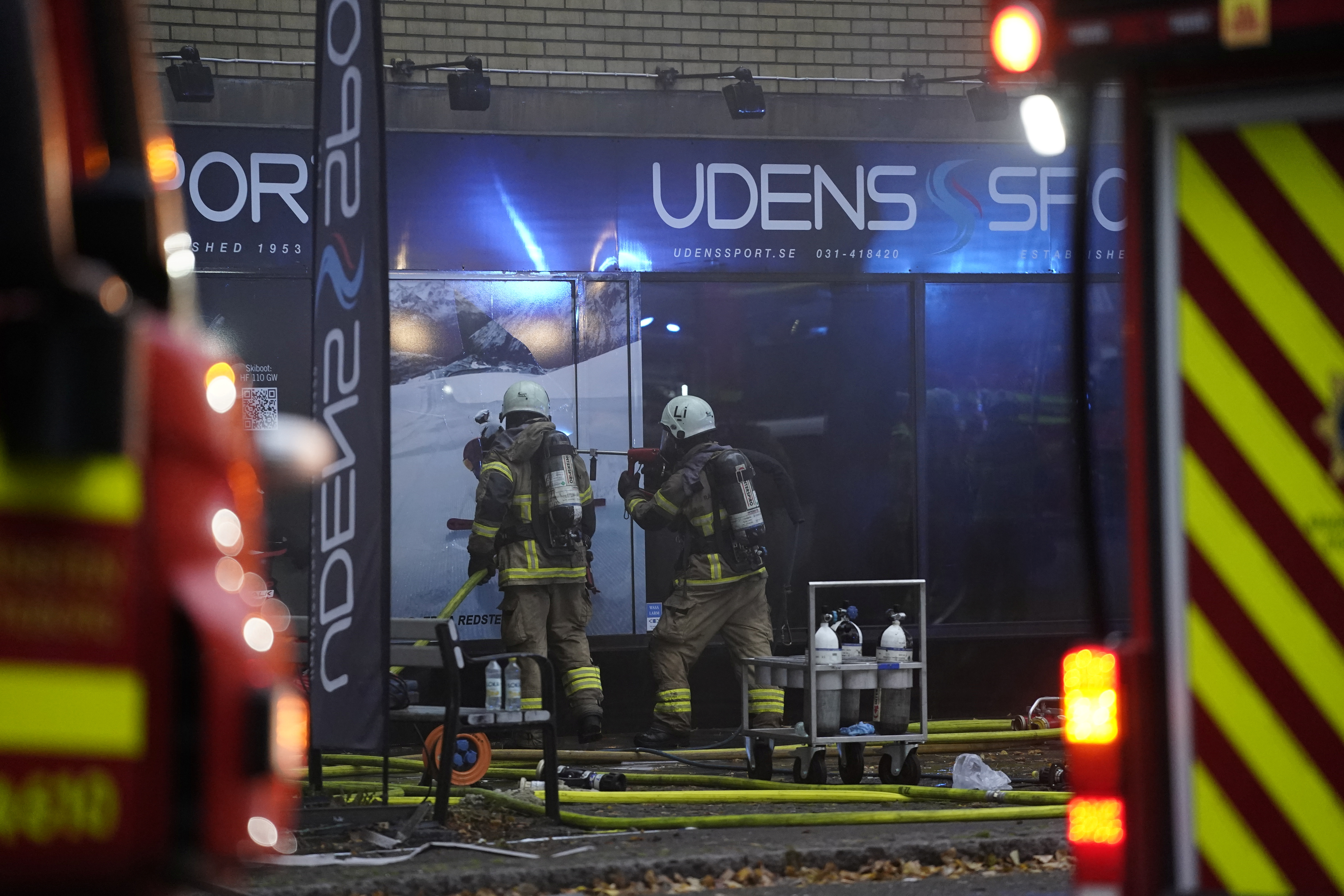 An emergency services crew works to evacuate people and put out fire after an explosion hit an apartment building in Annedal, central Gothenburg, Sweden September 28, 2021. Larsson Rosvall / TT News Agency/via REUTERS
