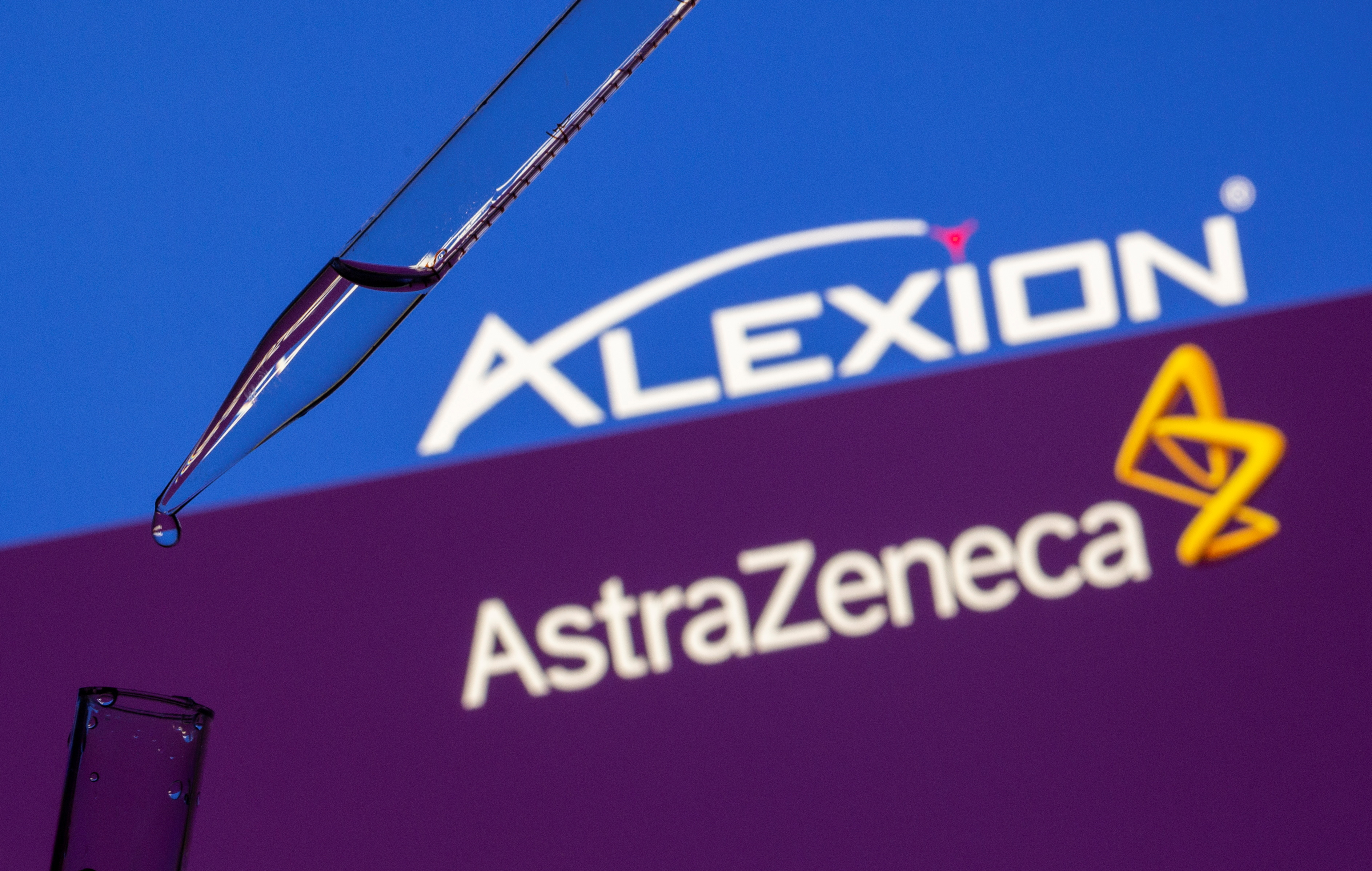 A test tube is seen in front of displayed Alexion Pharma and AstraZeneca logos in this illustration taken on July 14, 2021. REUTERS/Dado Ruvic/Illustratio