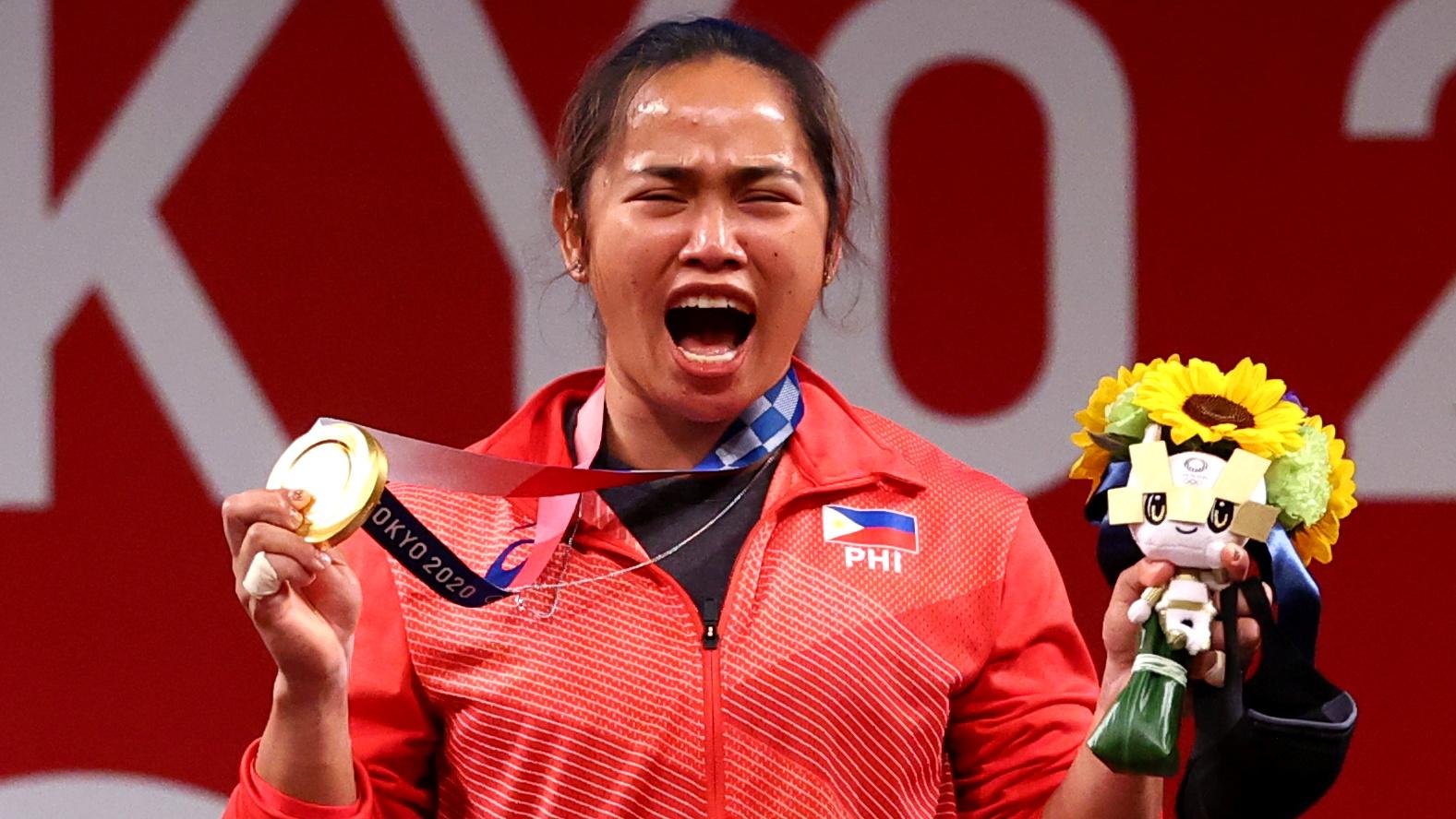 Tokyo 2020 Olympics - Weightlifting - Women's 55kg - Medal Ceremony - Tokyo International Forum, Tokyo, Japan - July 26, 2021. Gold medalist Hidilyn Diaz of the Philippines reacts. REUTERS/Edgard Garrido