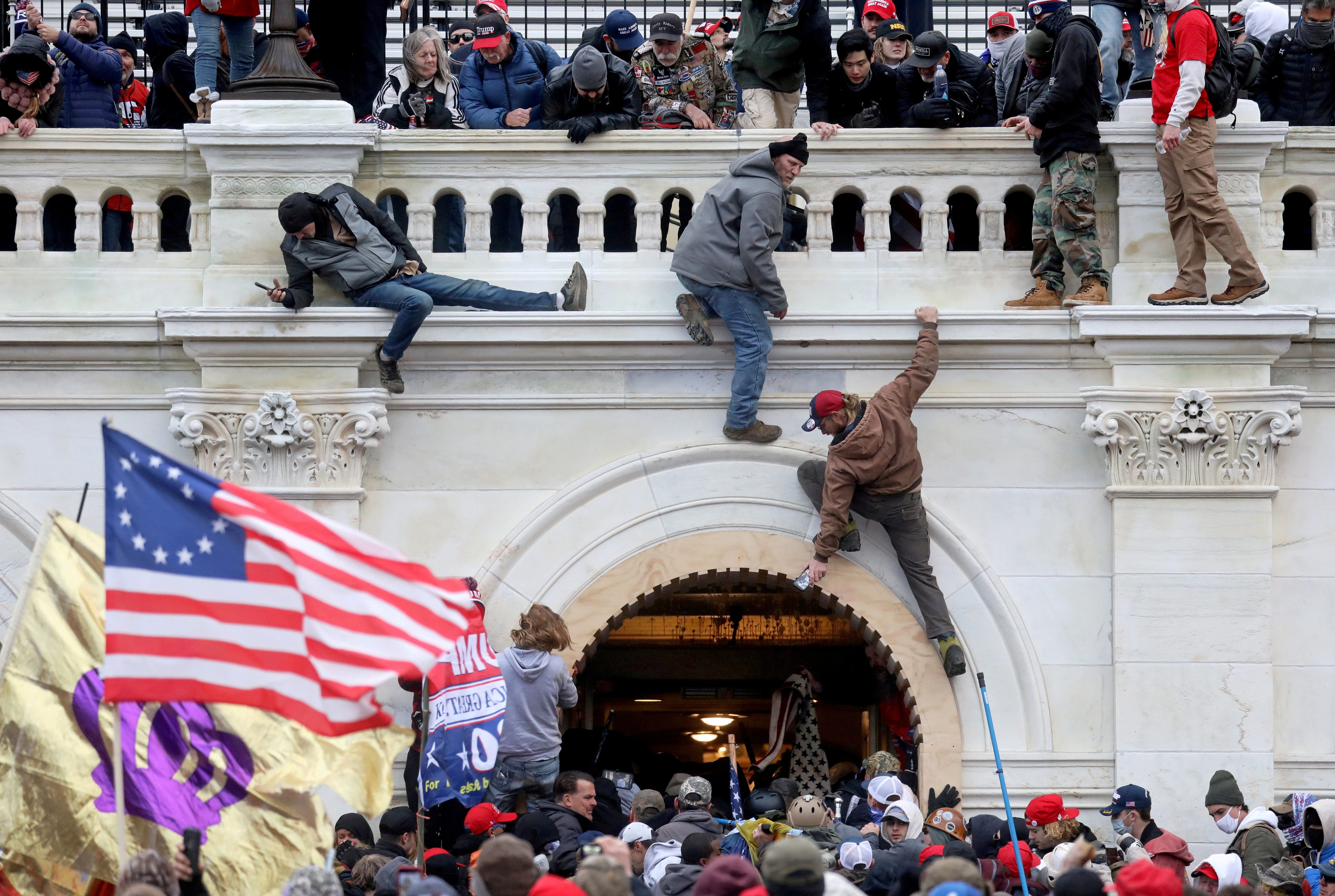 A mob of supporters of U.S. President Donald Trump fight with members of law enforcement at a door they broke open as they storm the U.S. Capitol Building in Washington, U.S., January 6, 2021. REUTERS/Leah Millis