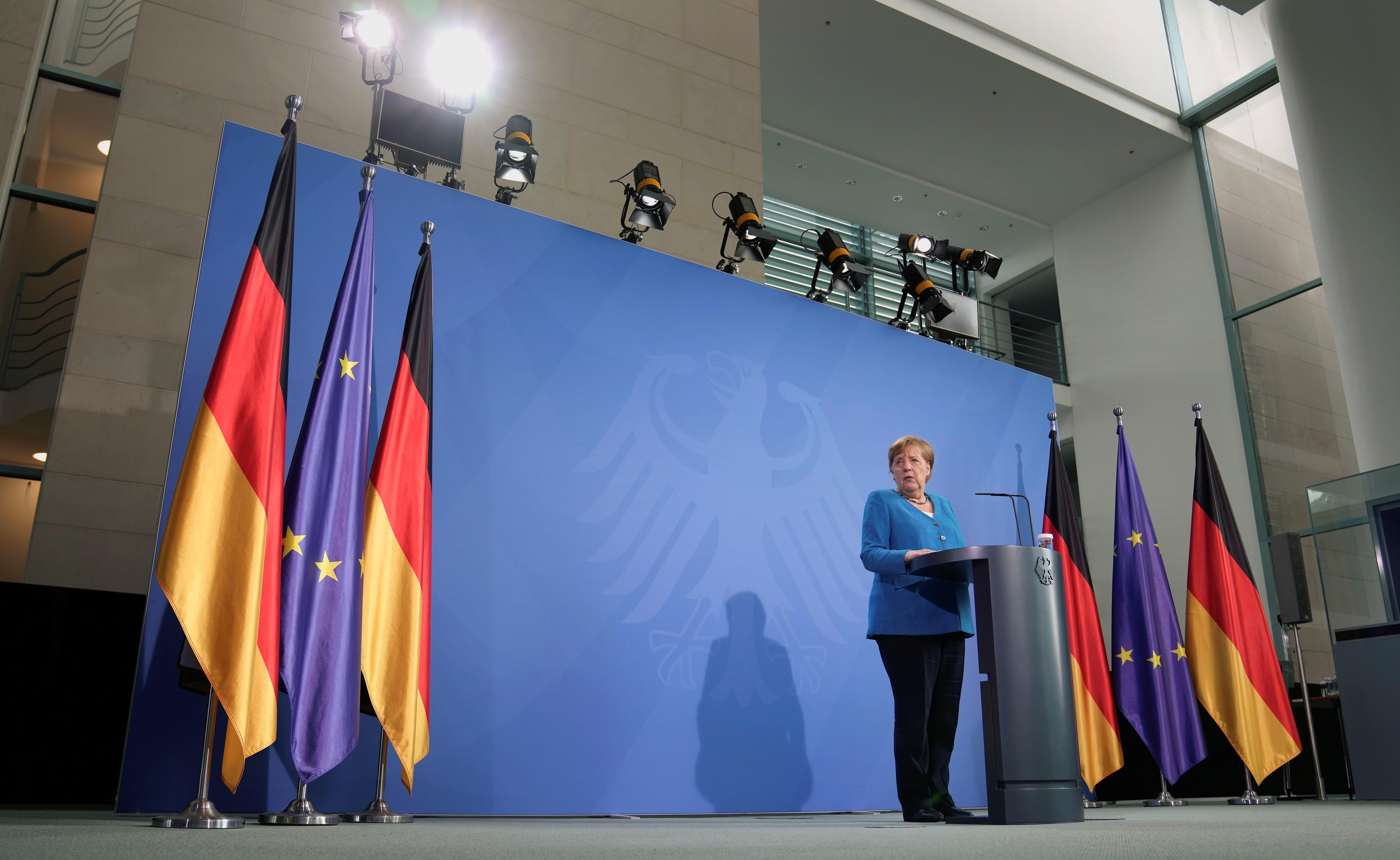 German Chancellor Angela Merkel addresses the media after a virtual
