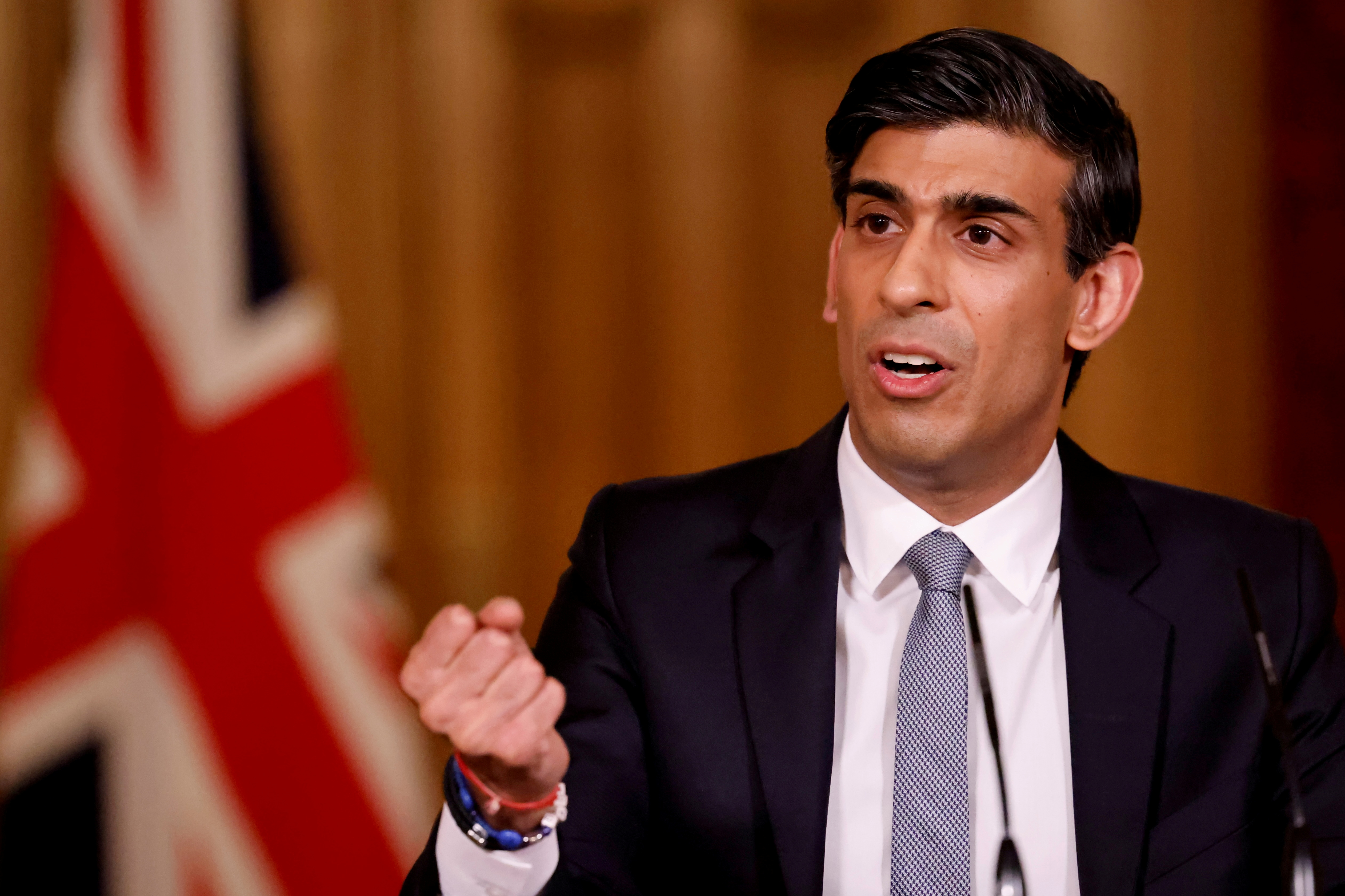 Britain's Chancellor of the Exchequer (finance minister) Rishi Sunak attends a virtual press conference inside 10 Downing Street in central London, Britain March 3, 2021. Tolga Akmen/Pool via REUTERS/File Photo