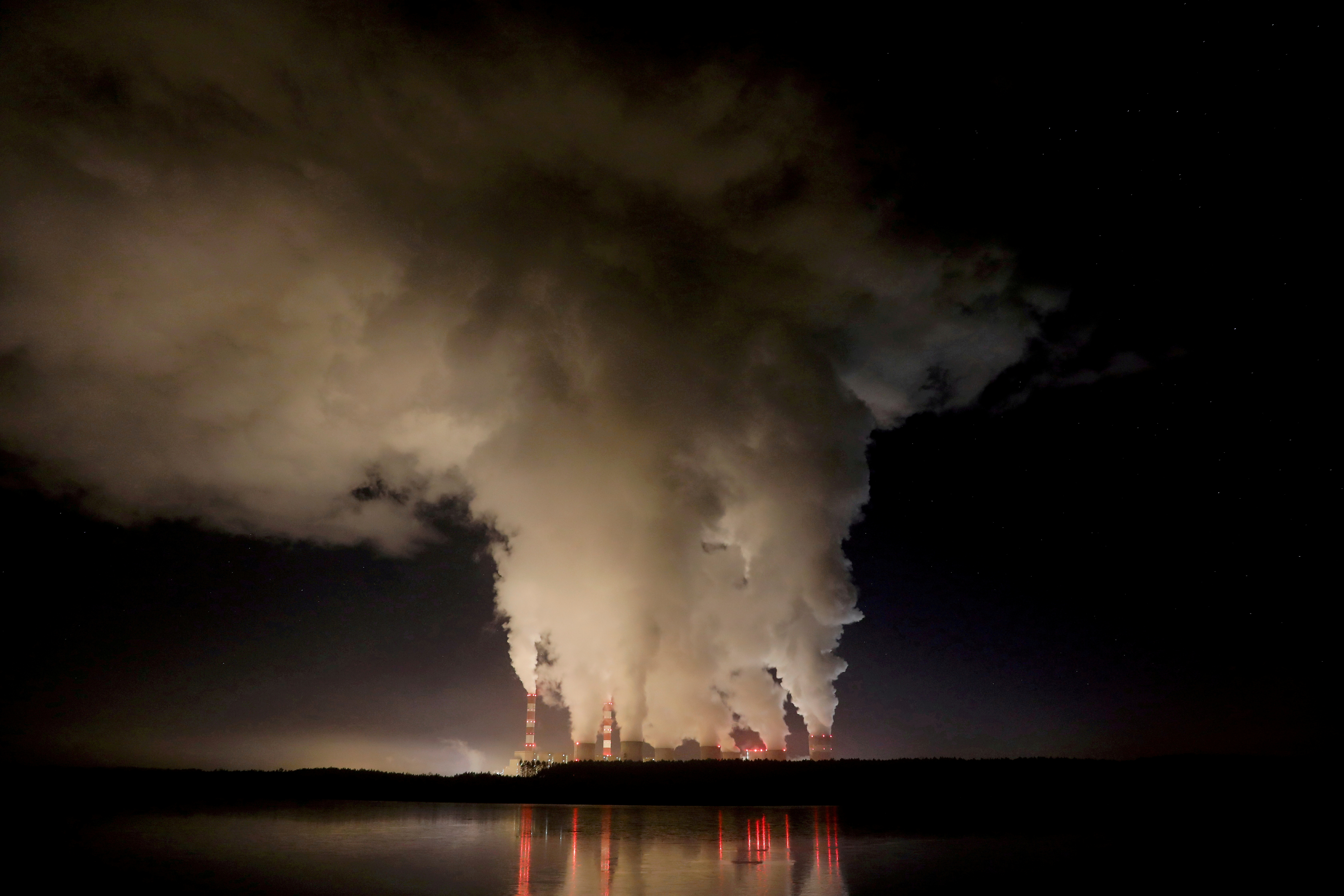 Smoke and steam billow from Belchatow Power Station, Europe's largest coal-fired power plant, operated by PGE Group, at night near Belchatow, Poland December 5, 2018. REUTERS/Kacper Pempel/File Photo