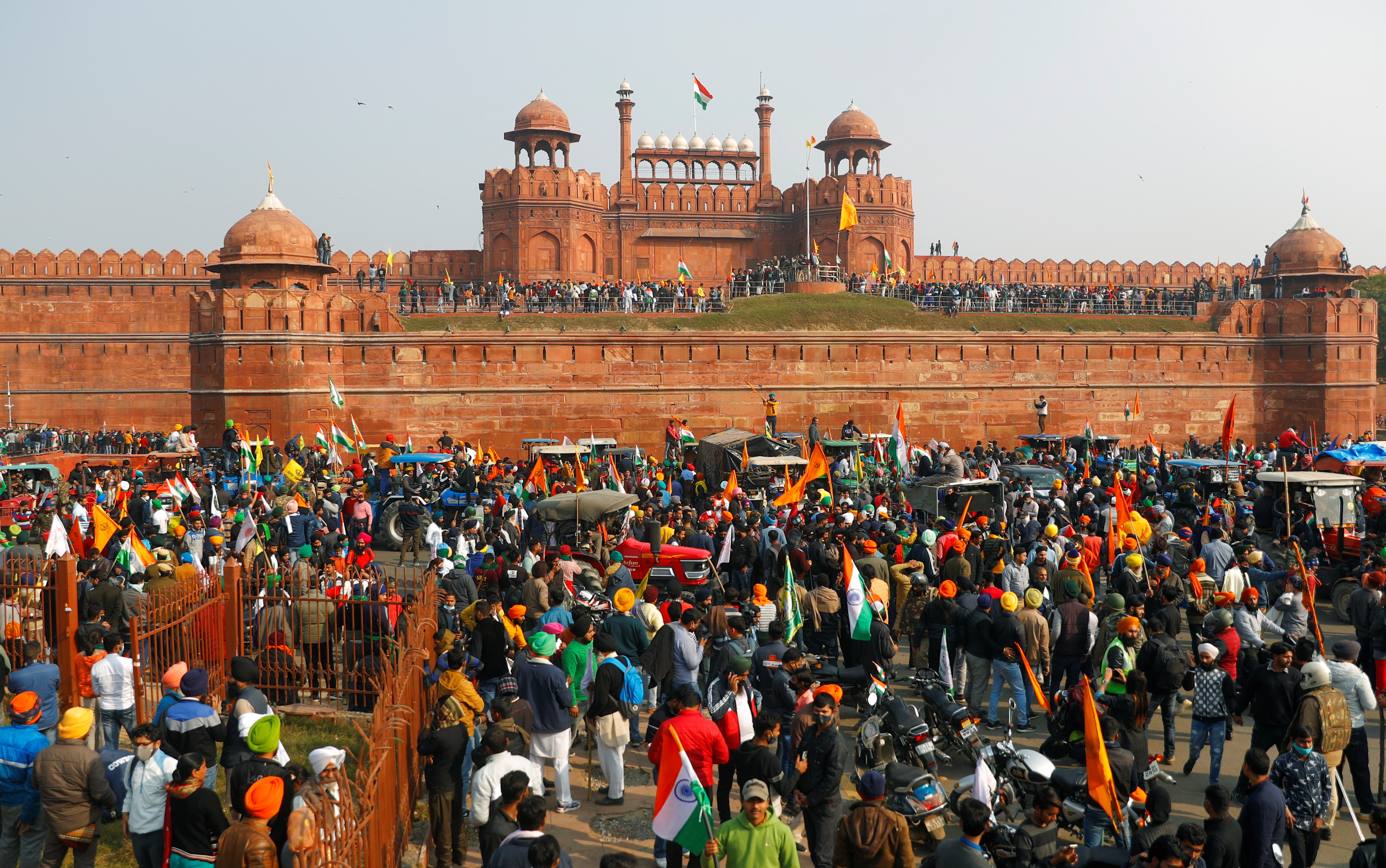Farmers gather in front of the historic Red Fort during a protest against farm laws introduced by the government, in Delhi, India, January 26, 2021. REUTERS/Adnan Abidi