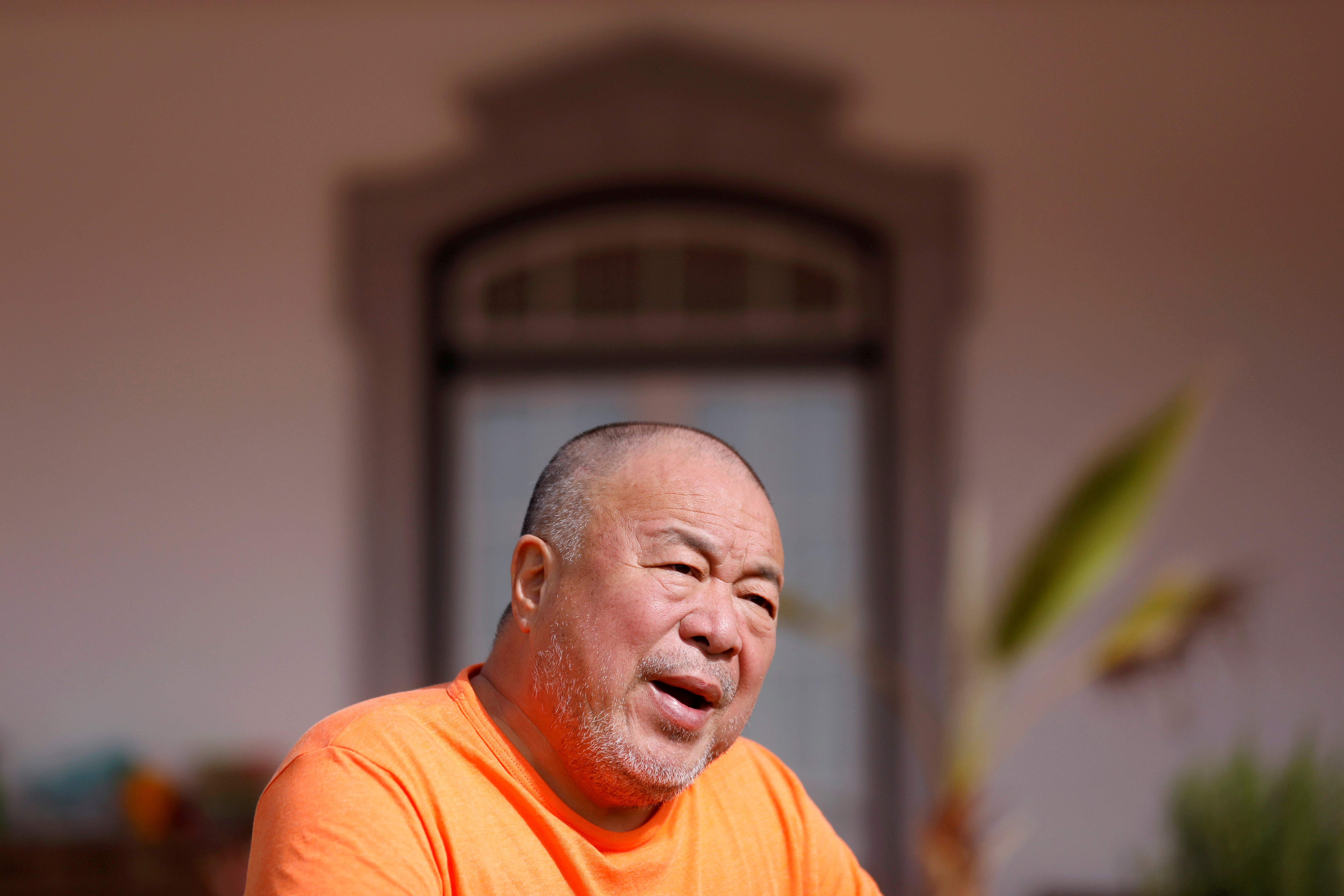 Chinese dissident artist Ai Weiwei speaks during an interview with Reuters in Montemor-O-Novo, Portugal, March 3, 2021. Picture taken March 3, 2021. REUTERS/Pedro Nunes/File Photo