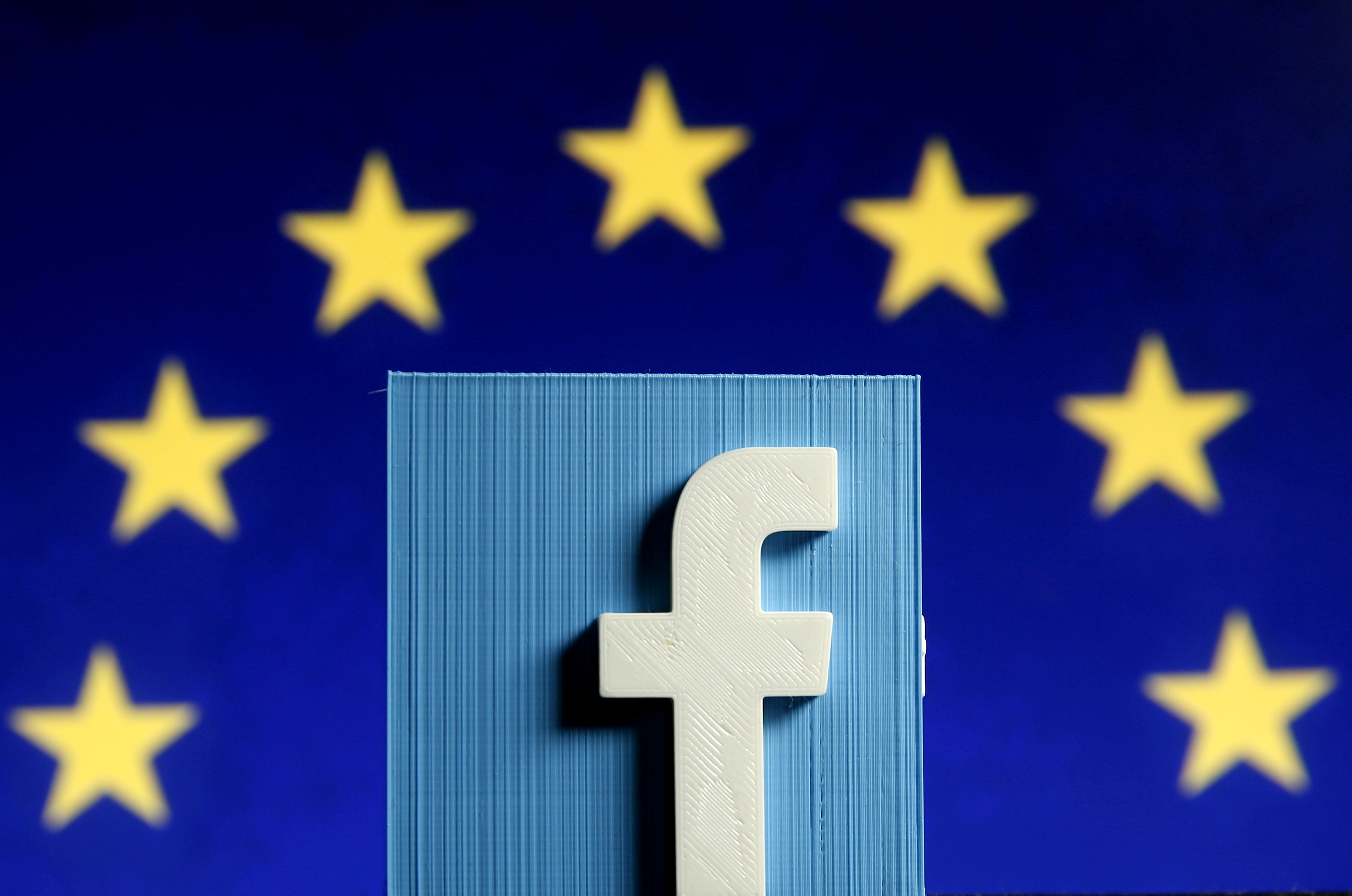 Facebook logo in 3D in front of the EU flag, May 15, 2015.  REUTERS/Dado Ruvic