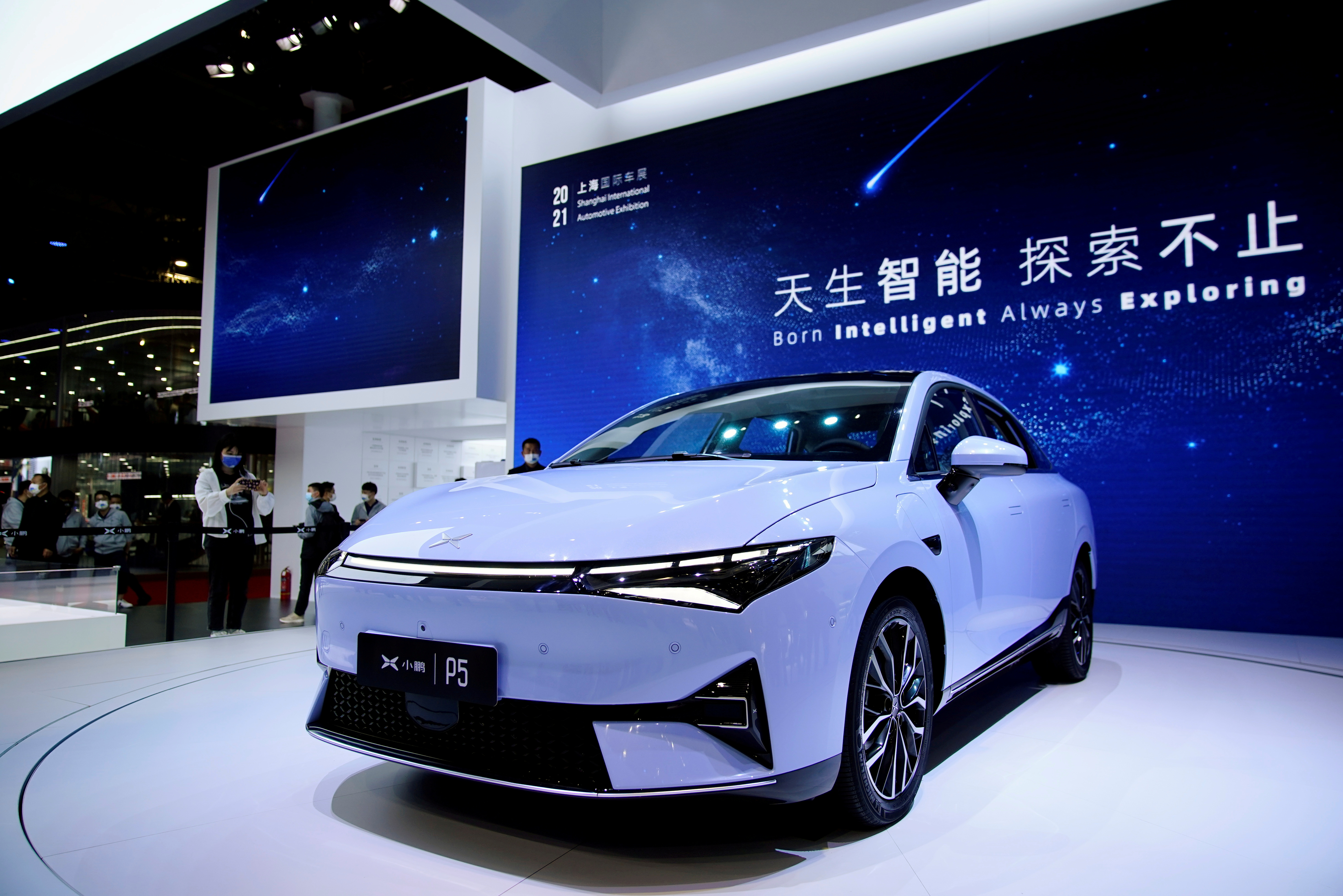 An Xpeng P5 electric vehicle (EV) is seen displayed during a media day for the Auto Shanghai show in Shanghai, China April 19, 2021. REUTERS/Aly Song/File Photo