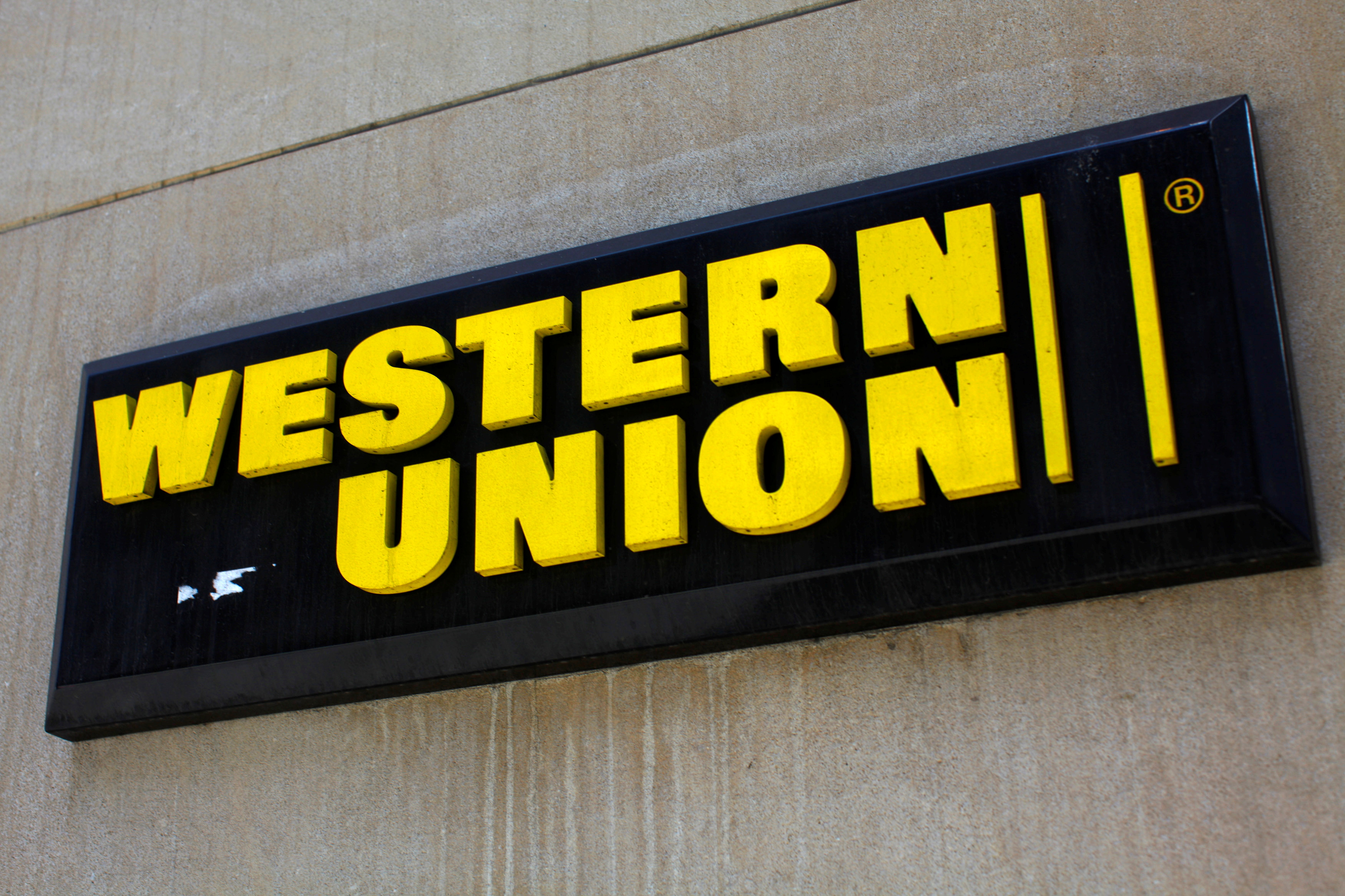 A Western Union sign is seen in New York March 28, 2009. Picture taken March 28, 2009.  REUTERS/Eric Thayer/File Photo